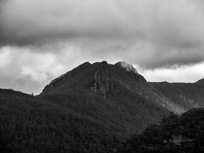 A stormy sky over the rugged rock face of Mt Montagu behind Mt Wellington - in Mono.